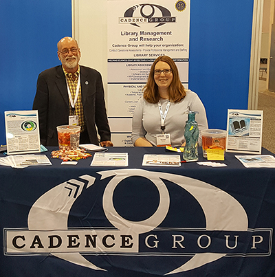Photo of Staff at Cadence Group Conference Booth.