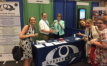 Cadence Group Staff at Conference Booth